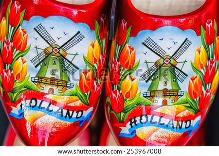 Clogs for sale at a Dutch retail shop. Wooden shoes are a well know traditional souvenir from Holland - stock photo