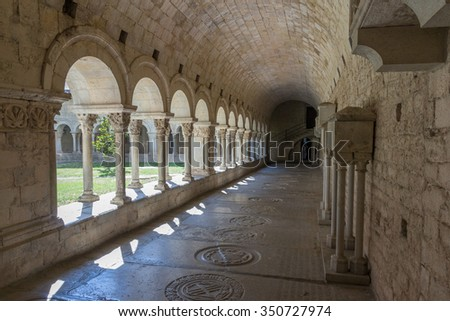 Cloister and archway of famous medieval Girona cathedral, Catalonia, Spain - stock photo