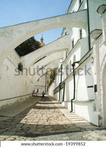 Cloister arcade (The Medieval monastery arcade on the territory of the Kiev Laura of the Caves) - stock photo