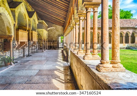 Cloister of San Zeno Cathedral in Verona showing ornate arches and carvings, Italy - stock photo