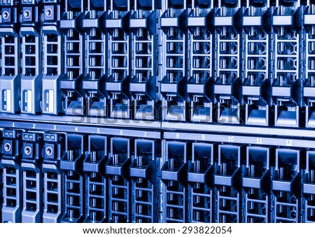 clos up network attached storage (NAS) with blue light - stock photo
