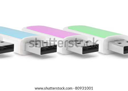 Close and low level capturing several usb memory sticks arranged horizontally over white - stock photo
