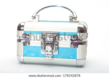 Close blue  treasure box  with jewelry on white - stock photo