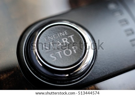 Close Detail of the start stop button in a luxury Car