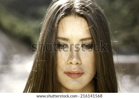 Close head shot portrait of a brown eye girl with golden light
