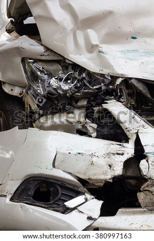 Close headlight white sedan, which was demolished due to a serious accident.