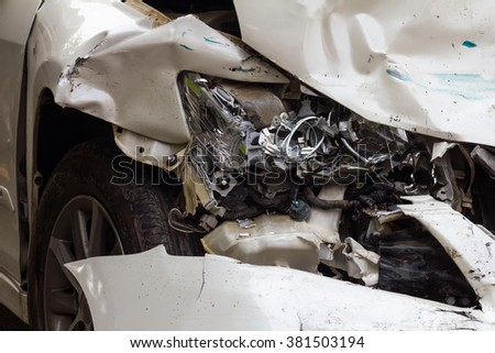 Close headlight white sedan, which was demolished due to a serious accident. - stock photo