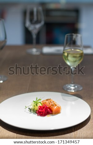 Close image of salmon on dish in restaurant