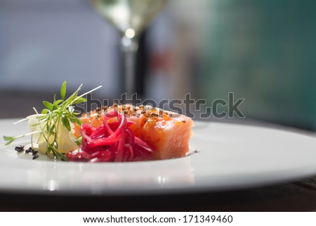 Close image of salmon on dish in restaurant - stock photo