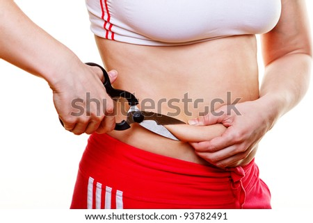 Close image of stomach with excess weight and scissors - stock photo