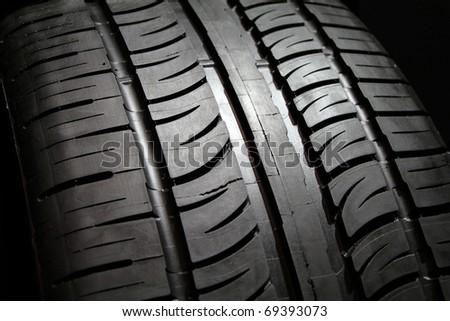 Close image or new vehicle tire tread pattern.