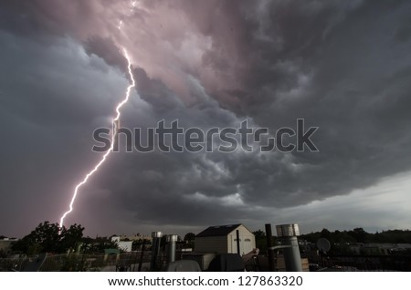 Close lightning strike over Brooklyn rooftops. - stock photo
