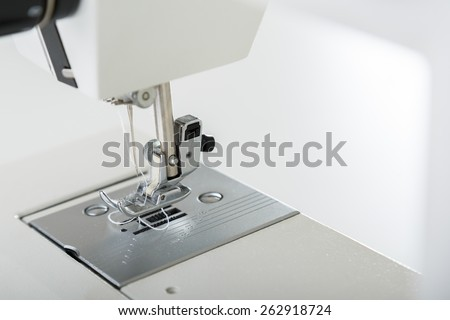 Close look of sewing machine needle - stock photo