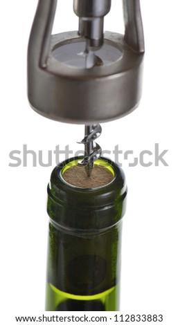 Close macro shot of cork screw opening a bottle of red wine isolated on white