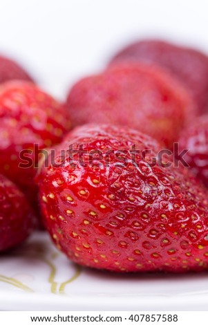 Close macro shot of fresh red strawberries.