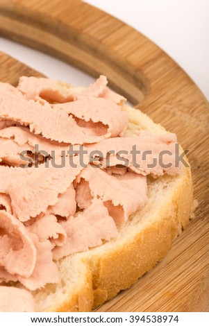 Close macro view of chicken liver pate sandwich.