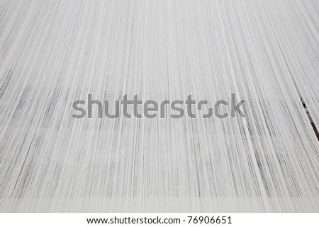 close of cotton yarn on a warping machine of a textile mill - stock photo