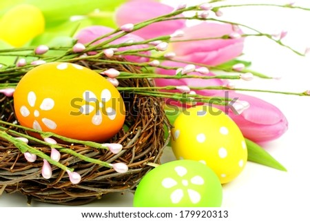 Close of of Easter eggs and nest with tulips