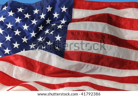 Close of of U.S. Flag fluttering in the breeze..