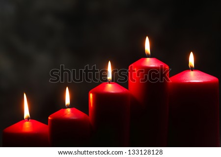 close of the candle with different height - stock photo