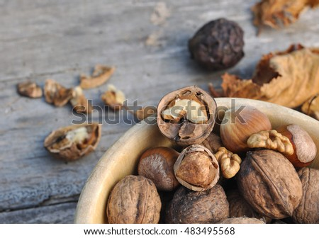 close on shelled hazelnuts and walnuts in a wooden bowl