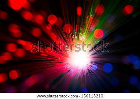 Close op of fiber optics, defocused background - stock photo