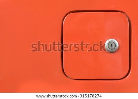 close petrol oil cap cover on orange car - stock photo