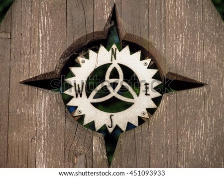 close photo of nice wooden compass rose