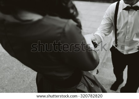 close picture of a beautiful couple where the guy takes the girl's hand