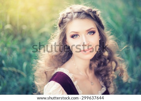 Close portrait of a beautiful girl on the background of a summer sunset prirodysh