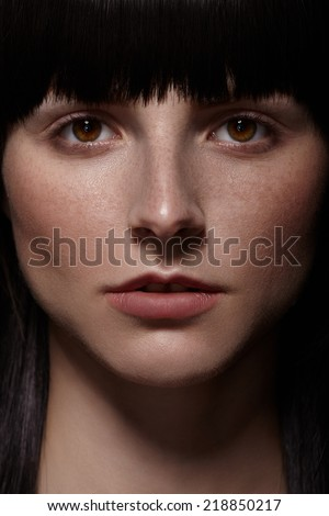 Close portrait of a beautiful young woman.