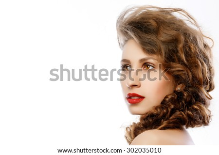 Close portrait of a girl a good make-up hair studio - stock photo