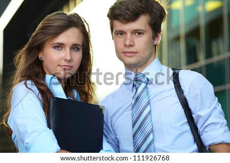 Close portrait of a smiling attractive business young couple, outdoor shoot - stock photo