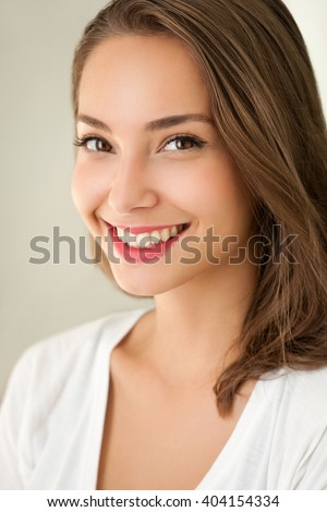 Close portrait of a tanned brunette summer beauty. - stock photo