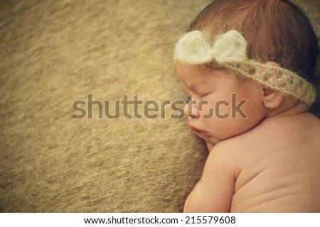 Close Portrait of Newborn Baby Sleeping with Band - stock photo