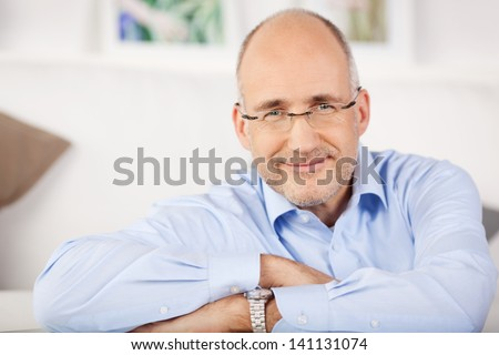 Close portrait of smiling man relaxing at home - stock photo