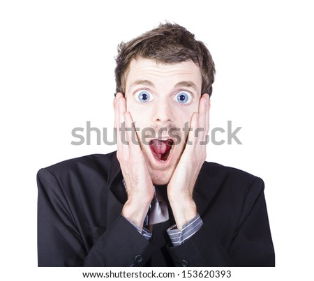 Close portrait on the face of a funny man with crazy surprised look holding head in amazement over white background. Eye popping and jaw dropping concept