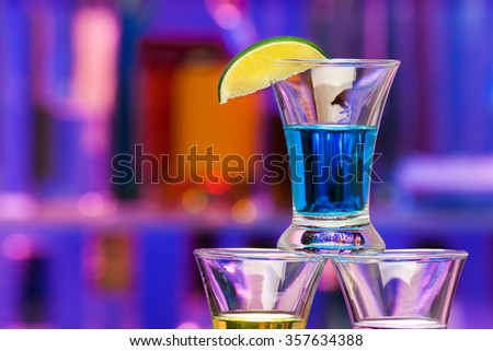 Close shoot of alcohol drink with lime in bar - stock photo