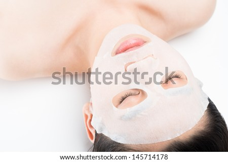 Close-shot of a female face having spa procedure isolated on white - stock photo