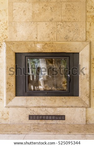 Close shot of living room corner with the marble closed fireplace