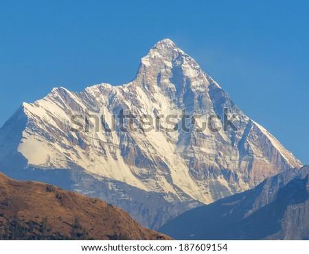 close shot of Mountain Nanda devi in Indian Himalaya - stock photo