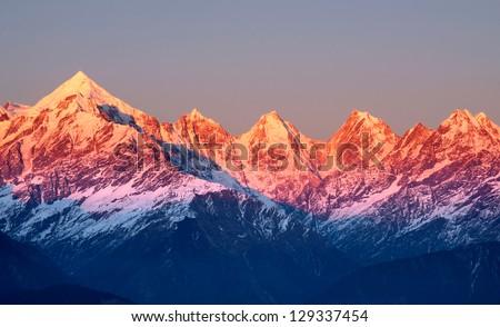 close shot of reddish mountain peaks during sun set - stock photo
