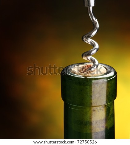 Close the bottle with the corkscrew. - stock photo