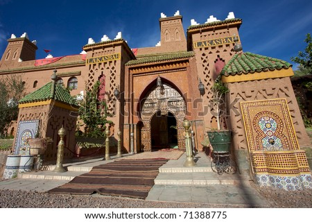 Close to Marrakesh, beautiful riad with mosaic and wood massive door - stock photo
