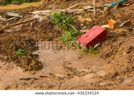 Close to the river, soil erosion, land slides, ruins and debris. - stock photo