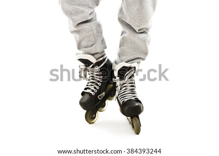 Close up a Boy Legs in Roller Skates. Isolated On White Background