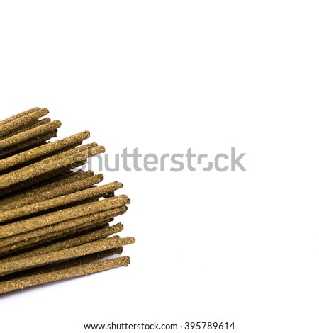 Close-up a bunch of incense sticks isolated on white. Incense use in religious ritual.Its burned to intend as a sacrificial offering to various deity or to serve as an aid in prayer. Copy space.