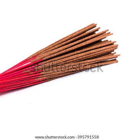 Close-up a bunch of incense sticks isolated on white. Incense use in religious ritual popular in Vietnam.Its burned to intend as a sacrificial offering to various deity or to serve as an aid in prayer