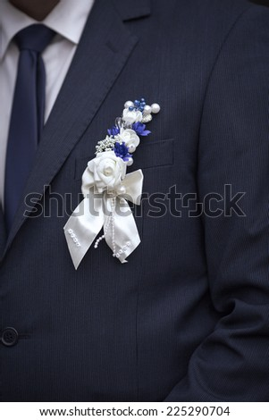 Close up a buttonhole of the groom from flowers - stock photo