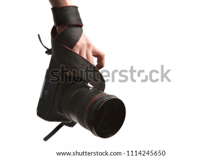 stock-photo-close-up-a-hand-holds-dslr-p